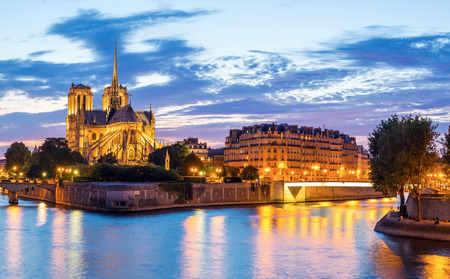 Notre Dame Cathedral with Paris cityscape panorama at dusk, France