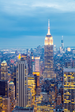 city square: New York City skyline with urban skyscrapers at dusk, USA  Stock Photo