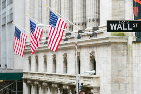 american city: Wall street sign in New York with New York Stock Exchange background