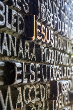 jesus word: Jesus word carving on wall Editorial