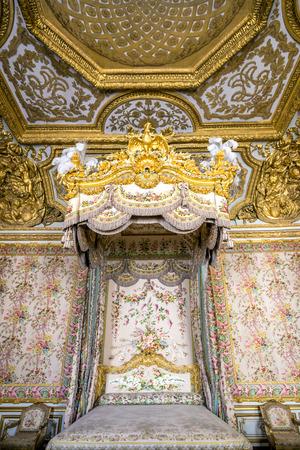 Versailles, France - JUN 20: Interior of royal bedrooml at Chateau de Versailles (Palace of Versailles) on June 20, 2014, France. Versailles palace is in UNESCO World Heritage Site list since 1979.
