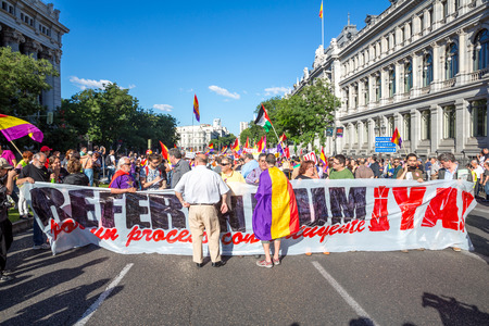anti racist: Madrid - JUN 7: Thousands of protesters have taken to the streets of Madrid to demand a referendum to abolish Spains monarchy on Jun 7, 2014 in Madrid, Spain.