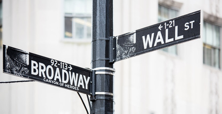 new economy: Wall street and broadway sign in New York Stock Photo