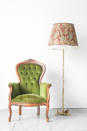 Green classical style Armchair sofa couch in vintage room with desk lamp photo