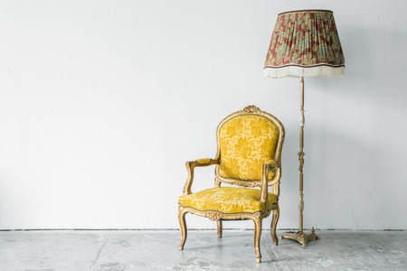 desk lamp: Classical style Armchair sofa with desk lamp Editorial
