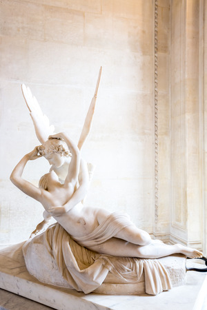 Paris - June 23: Cupid statue on June 23, 2014 in Paris. Antonio Canovas statue Psyche Revived by Cupids Kiss, first commissioned in 1787, exemplifies the Neoclassical devotion to love and emotion.