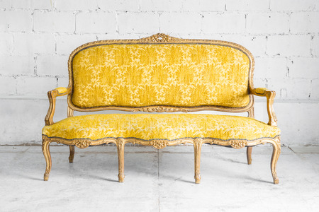 Yellow classical style Armchair sofa couch in vintage room photo