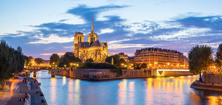 notre dame cathedral: Notre Dame Cathedral with Paris cityscape panorama at dusk, France