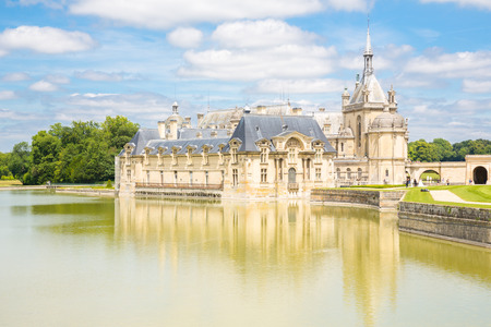 conde: CHANTILLY, FRANCE  -JUN 19 Chateau de Chantilly of France on June 19, 2014. It is a historic castle located in the town of Chantilly. It houses the Museum of Conde