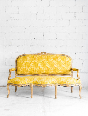 antique wood: Yellow classical style Armchair sofa couch in vintage room