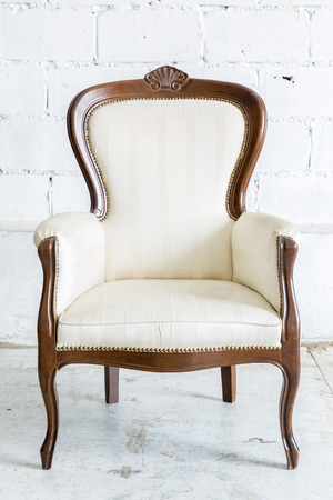 antique furniture: White Vintage classical farbirc style Chair Stock Photo