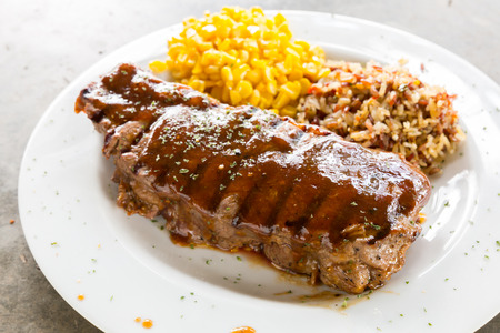 entree: Beef New York Steak with sweet corn and brown rice