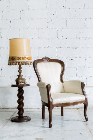 White Vintage retro style Chair with lamp photo