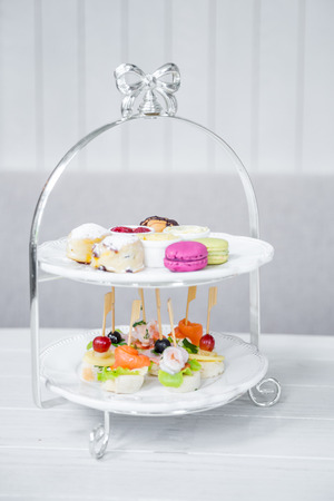 High Tea set with macaroons and Seafood cocktail