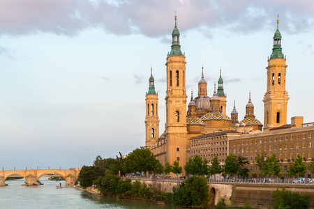 Our Lady of the Pillar Basilica with Ebro River at dusk Zaragoza, Spain photo