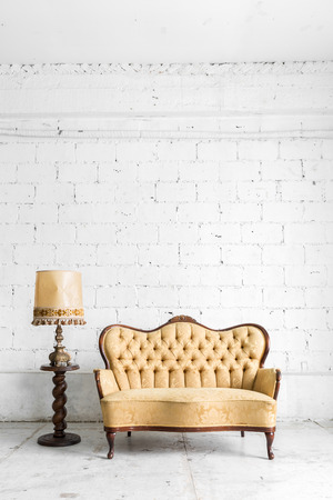 antique wood: Brown Classical style Armchair sofa couch in vintage room with desk lamp