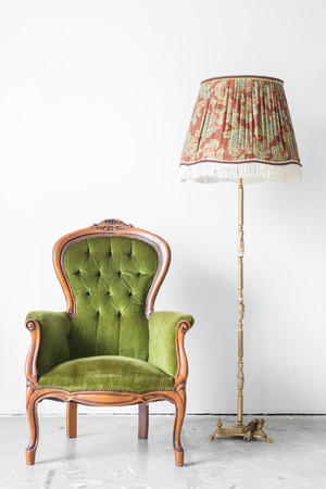 antique furniture: Green classical style Armchair sofa couch in vintage room with desk lamp Stock Photo