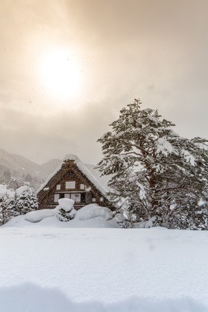 gifu: Shirakawago with Snowfall and winter Sun,  Gifu Chubu Japan Stock Photo