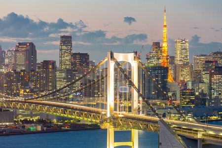Tokyo Tower skyline and Rainbow Bridge with cityscape at Odaiba Japan photo