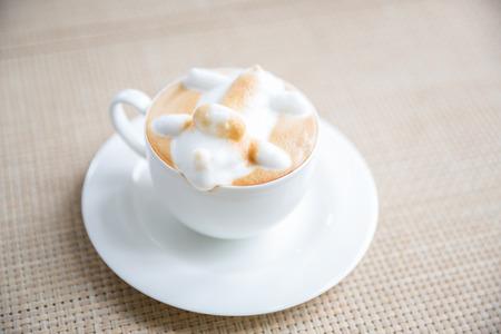 latte art: Coffee latte art in white cup Stock Photo