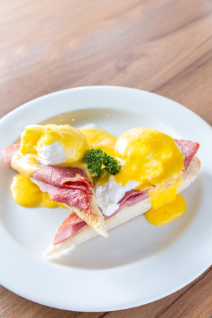 uk cuisine: Eggs Benedict breakfast- toasted English muffins, ham, poached eggs, with buttery hollandaise sauce