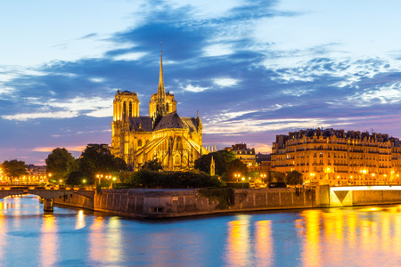 notre dame cathedral: Notre Dame Cathedral with Paris cityscape and River Seine at dusk, France Stock Photo