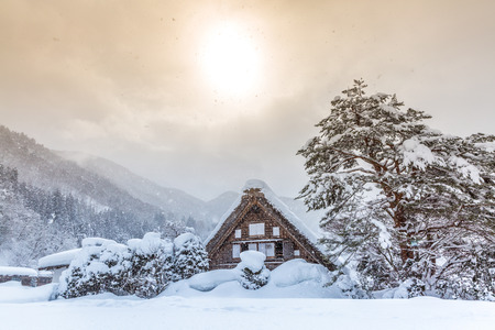 Shirakawago with Snowfall and winter Sun,  Gifu Chubu Japan Archivio Fotografico