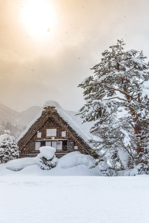 gassho zukuri: Shirakawago with Snowfall and winter Sun,  Gifu Chubu Japan Stock Photo