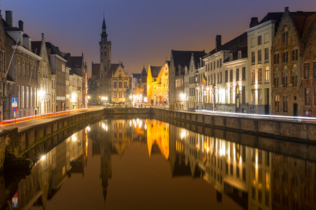 patronage: Historic medieval buildings in Bruges, Belgium at night.