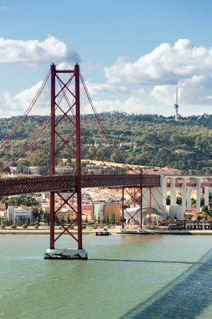 lisbonne: Lisbon cityscape with 25 de Abril suspension Bridge Portugal Stock Photo