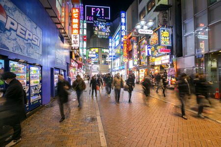 particularly: TOKYO  FEB 18: Pedestrians walking at Shibuya on Febuary 18 2015 in Tokyo Japan. Shibuya is known as one of the fashion centers of Japan particularly for young people and as a major nightlife area.