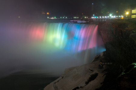 queen victoria: Illumination light at Horseshoe Falls viewed from Table Rock in Queen Victoria Park in Niagara Falls at night, Ontario, Canada