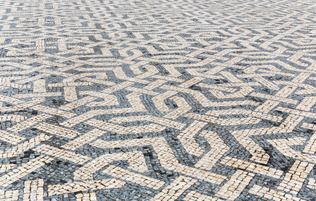 Tile brick floor in Lisbon Town Square, Portugal using as background photo