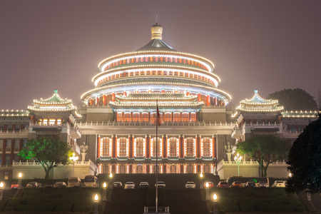 china people: Chongqing Great Hall of People at night in China Editorial