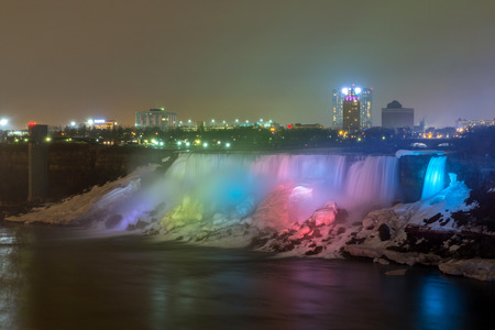 american falls: Illumination light of american Falls as viewed from Table Rock in Queen Victoria Park in Niagara Falls at night Ontario Canada