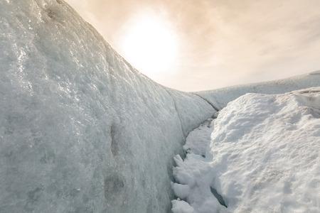 glacial: Glacial cave in vatnajokull in Iceland with sun Stock Photo