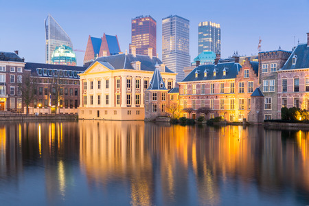 modern architecture: Binnenhof palace place of Parliament in The Hague of Netherlands at dusk Editorial