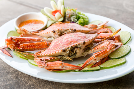 crab: steam red crab with lemon lime and spicy seafood sauce Stock Photo