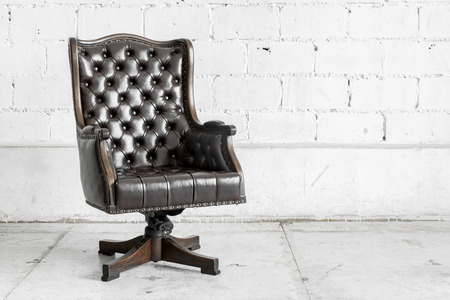 leather: Black genuine leather classical style sofa in vintage room