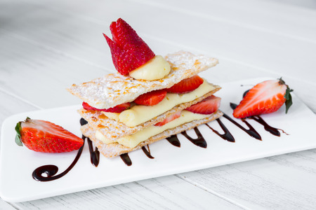mille: Strawberry Mille Feuille cake in white plate Stock Photo