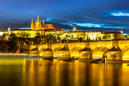 charles bridge: Pargue at dusk, view of the Lesser Bridge Tower of Charles Bridge Karluv Most and Prague Castle, Czech Republic.