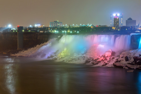 american falls: Illumination light of american Falls as viewed from Table Rock in Queen Victoria Park in Niagara Falls at night, Ontario, Canada