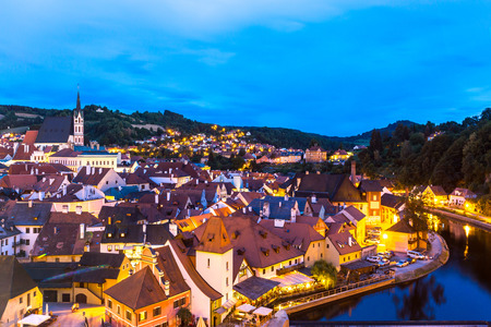czech: Aerial view of old Town of Cesky Krumlov, Czech Republic at dusk