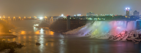 american falls: Panorama Illumination light of american Falls as viewed from Table Rock in Queen Victoria Park in Niagara Falls at night, Ontario, Canada