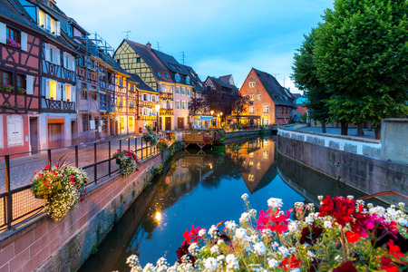 old city: Colmar, Petit Venice, at dusk water canal and traditional colorful houses. Alsace, France.