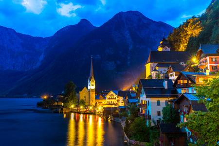 city by night: Classic view of Hallstatt village in Alps at dusk, Austria