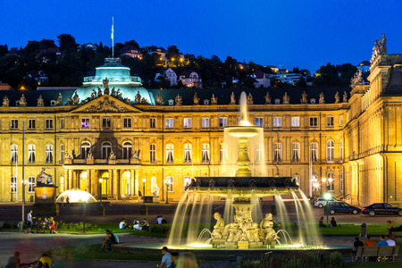 stuttgart: Fountain at neues Schloss New palace in Stuttgart city center, Germany at dusk