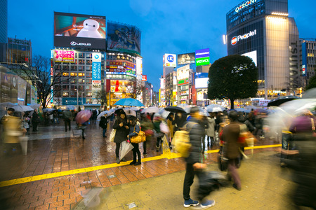 particularly: TOKYO - FEB 18: Pedestrians walking at Shibuya on Febuary 18, 2015 in Tokyo, Japan. Shibuya is known as one of the fashion centers of Japan, particularly for young people, and as a major nightlife area. Editorial