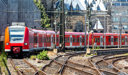 depart: red train depart frim the station Cologne Germany.