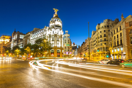 Gran Via, main shopping street in Madrid, Spain at dusk